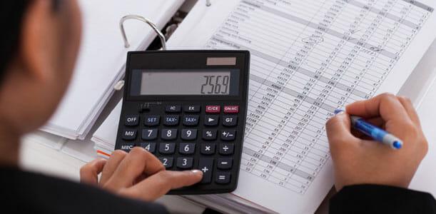 Woman Budgeting on Calculator